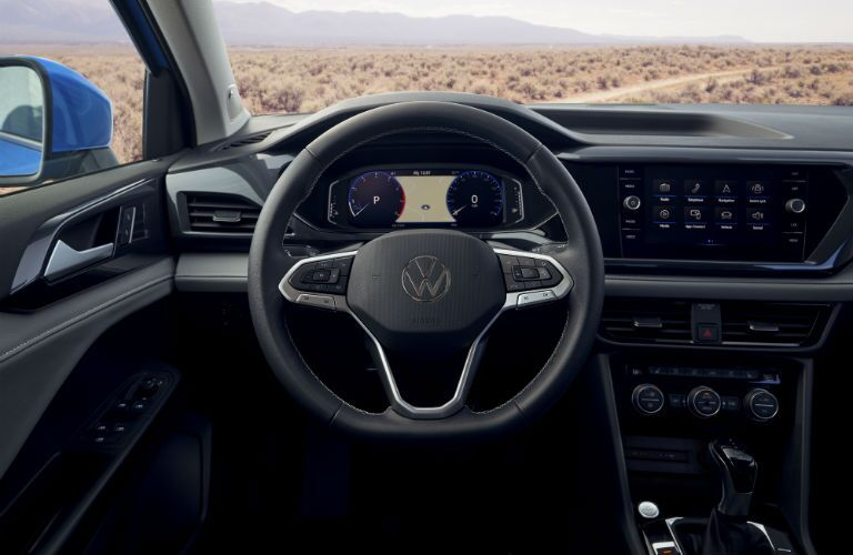 A photo of the driver's cockpit in the 2022 Volkswagen Taos.