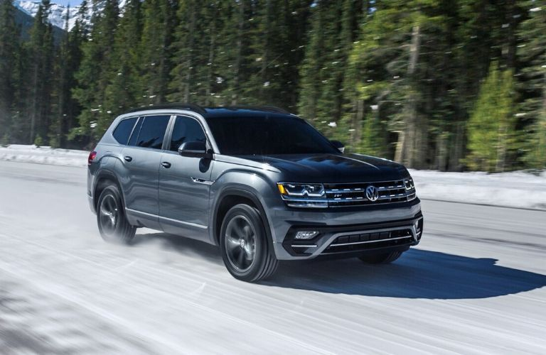 A front right profile of the 2020 VW Atlas on the road.