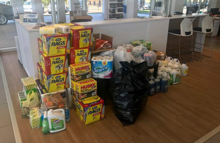 hurricane relief supplies from Team Gunther piled in front of a front desk