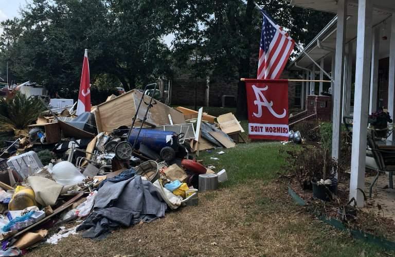 hurricane debris piled outside a house after Hurricane Irma