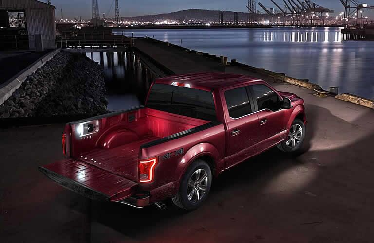 red 2016 Ford F-150 rear door at night