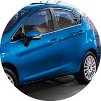 blue 2016 Ford Fiesta hatch exterior side