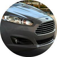 gray 2016 Ford Fiesta front grille and headlight