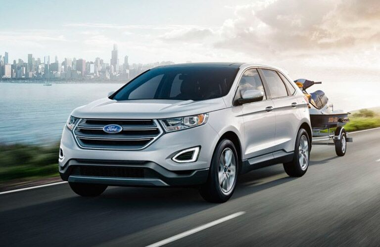silver 2017 Ford Edge towing jet ski