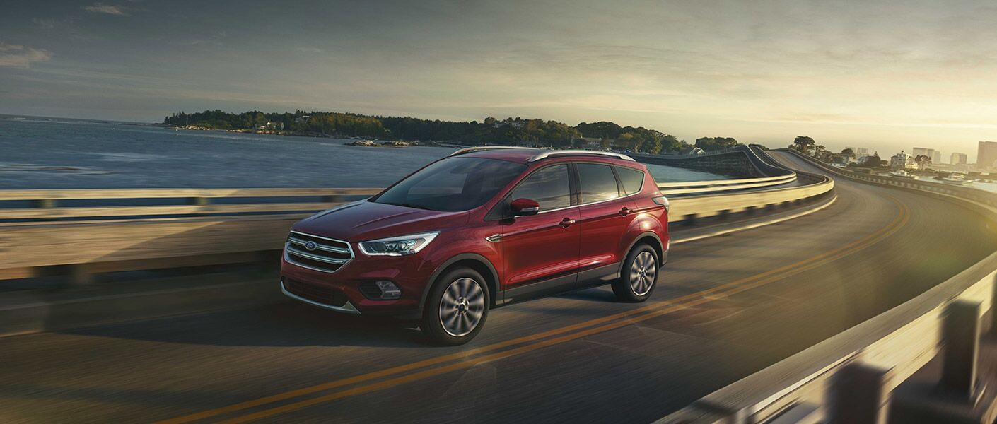 red 2017 Ford Escape driving on highway