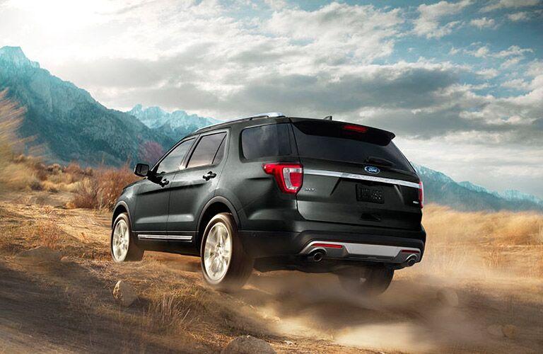 2017 Ford Explorer exterior rear riding into the mountainous landscape