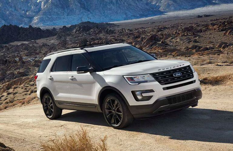 white 2017 Ford Explorer on a desert road