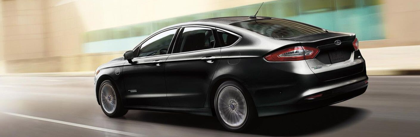 black 2017 Ford Fusion Energi exterior side rear