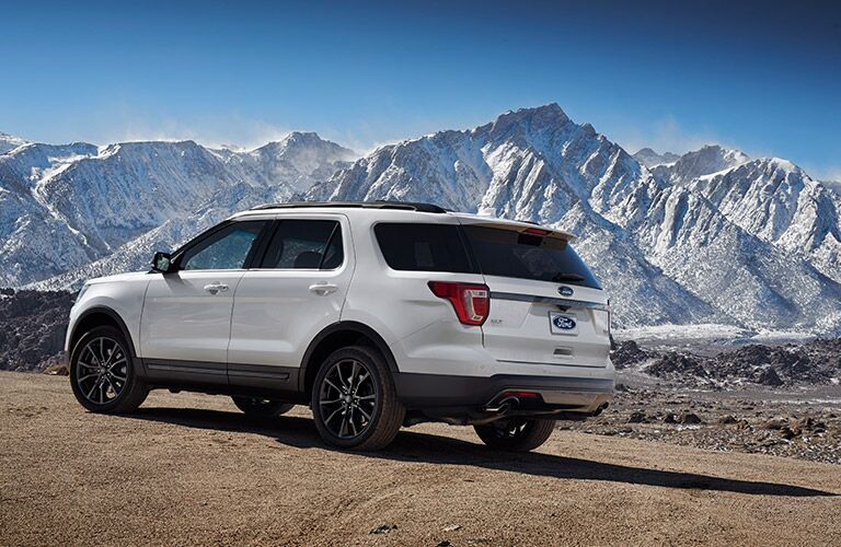 white 2017 Ford Explorer with snowy mountains in background