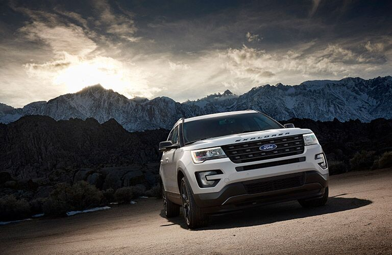 white 2017 Ford Explorer with cloudy mountain background