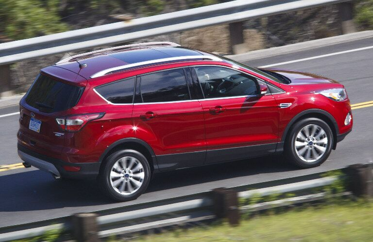 red 2017 Ford Escape on highway side view