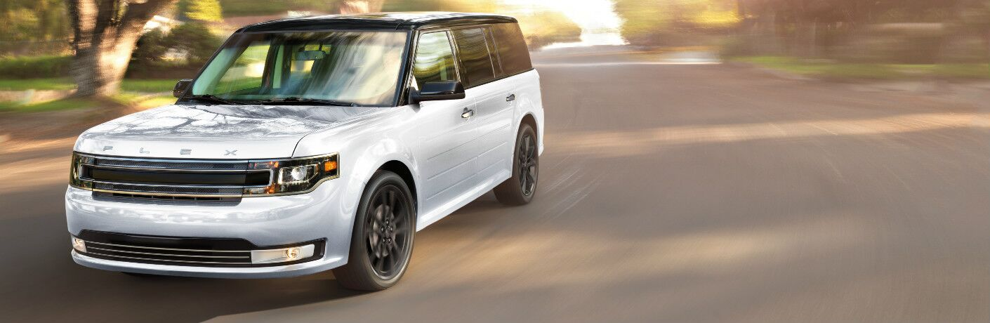 white 2017 Ford Flex exterior front driving down street