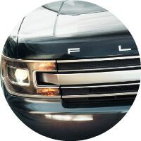 2017 Ford Flex headlight and part of front grille