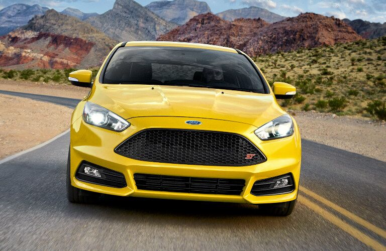 yellow 2017 Ford Focus driving on desert highway