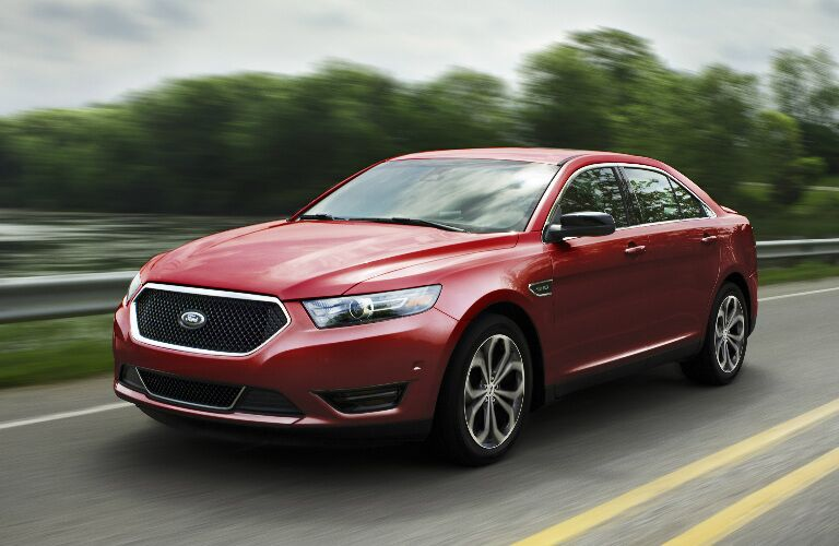 red 2017 Ford Taurus exterior front side driving down highway