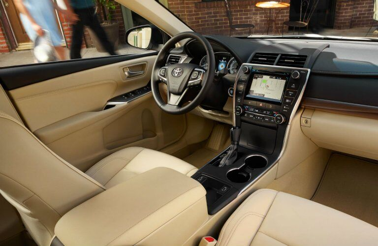 2017 Toyota Camry SE's beige interior from the passenger's seat