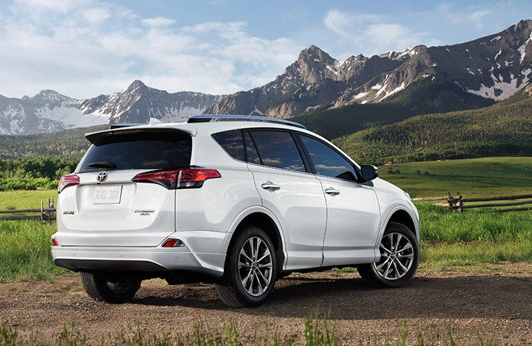 2017 Toyota RAV4 in white sitting in front of snow-topped mountains