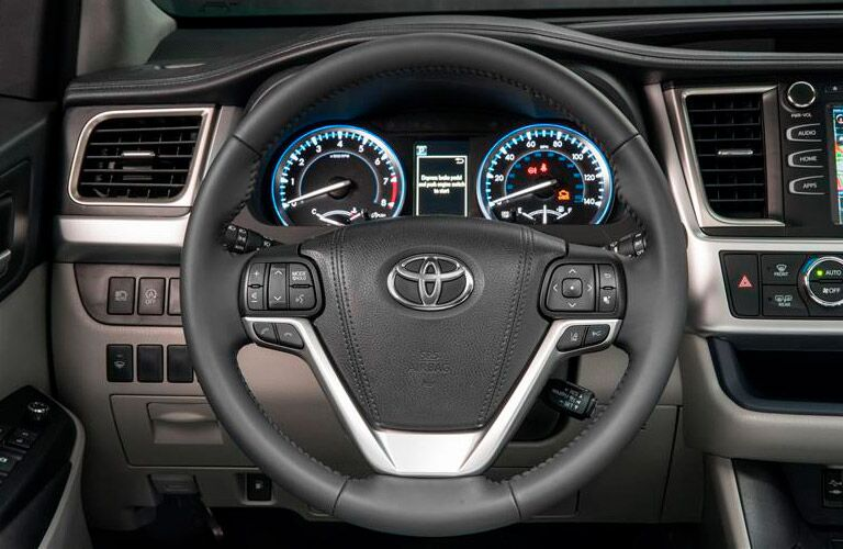 2018 Toyota Highlander Hybrid steering wheel and driver gauges