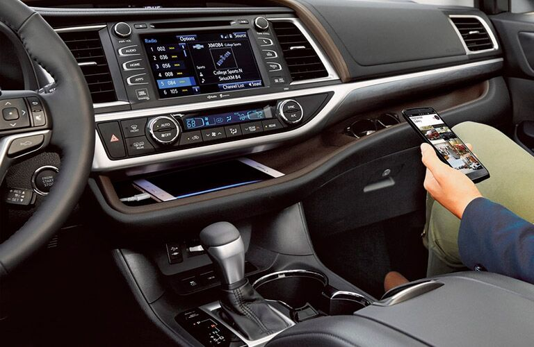 Passenger connecting their phone to the 2018 Toyota Highlander Hybrid infotainment system