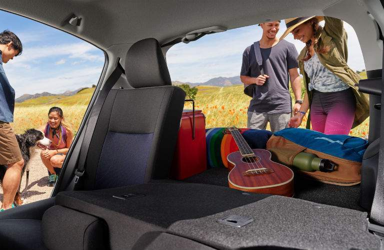 2018 Toyota Prius c cargo space holding a guitar and camping equipment