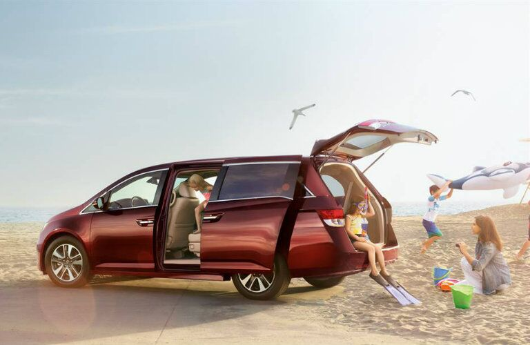 Exterior View of 2016 Honda Odyssey with Trunk Open and Sliding Side Door Ajar