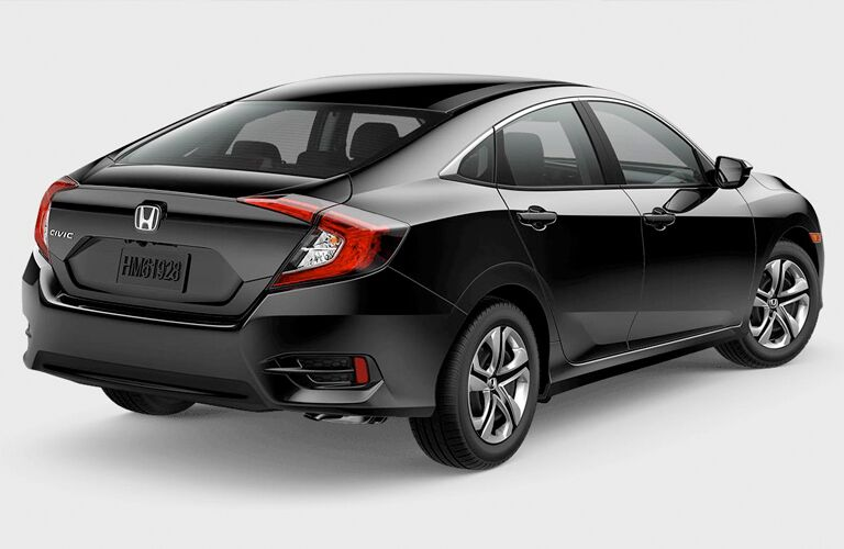 rear and side view of black 2018 honda civic sedan against white background