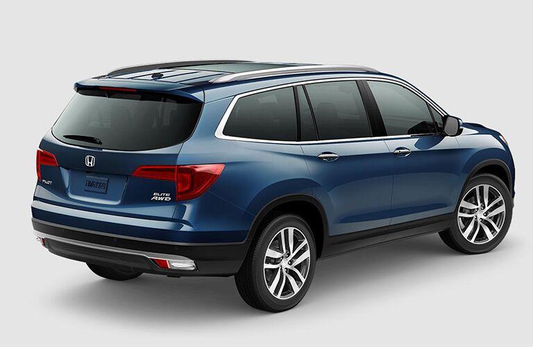 rear and side view of blue 2018 honda pilot against white background