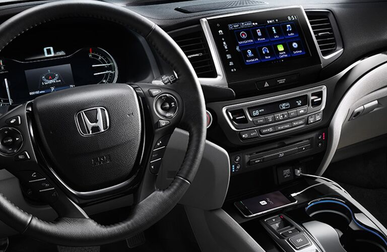 front interior of 2018 honda pilot including steering wheel and infotainment system