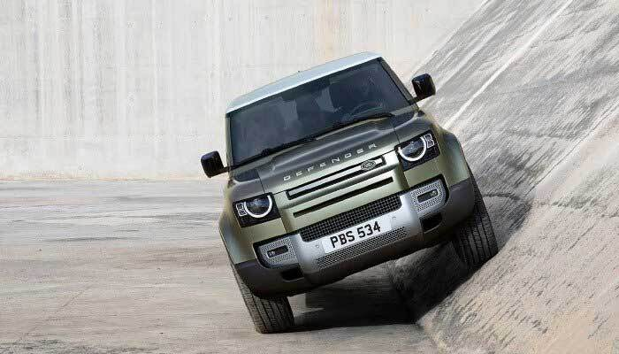Land Rover Defender riding up an aqueduct
