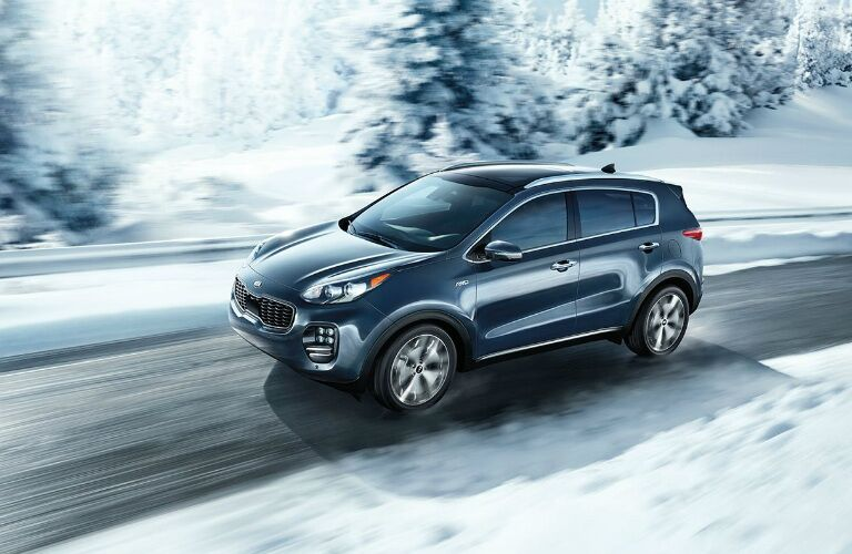 blue 2017 Kia Sorento driving on snowy road