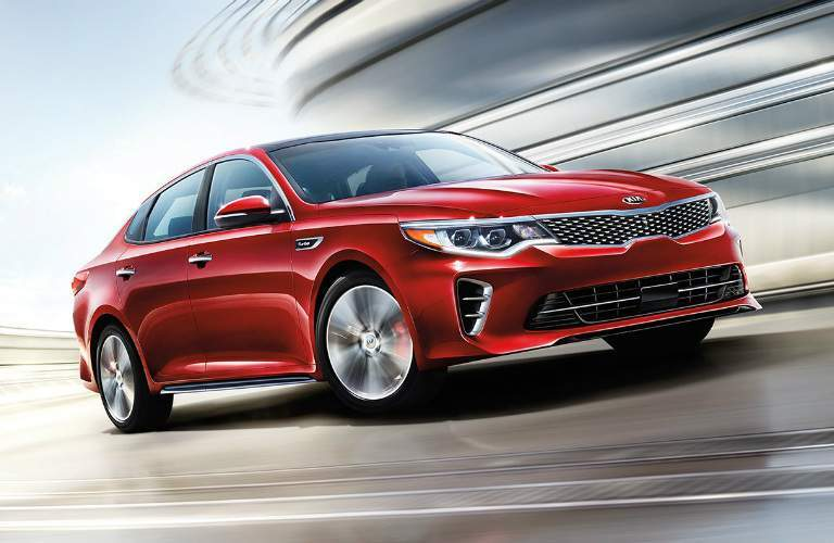 red 2018 Kia Optima making a left turn