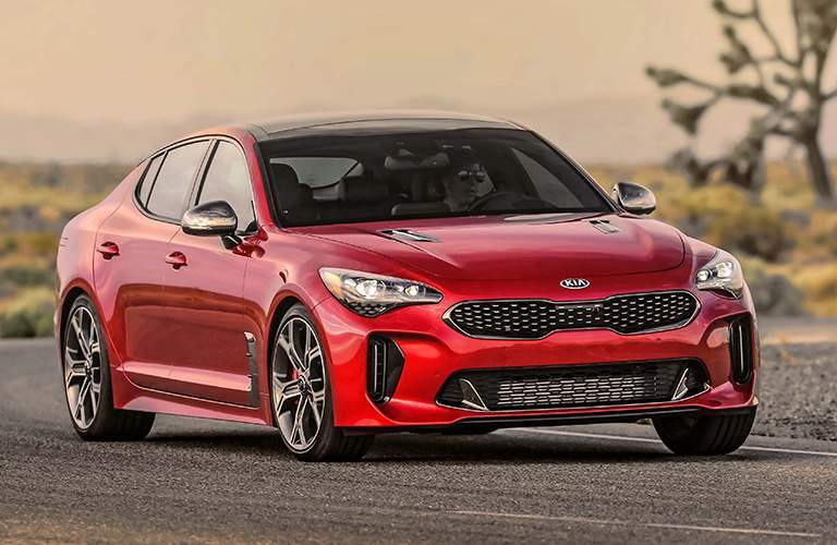 red kia stinger on road