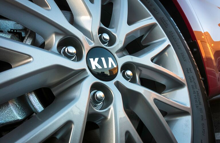 closeup of kia rio hubcap