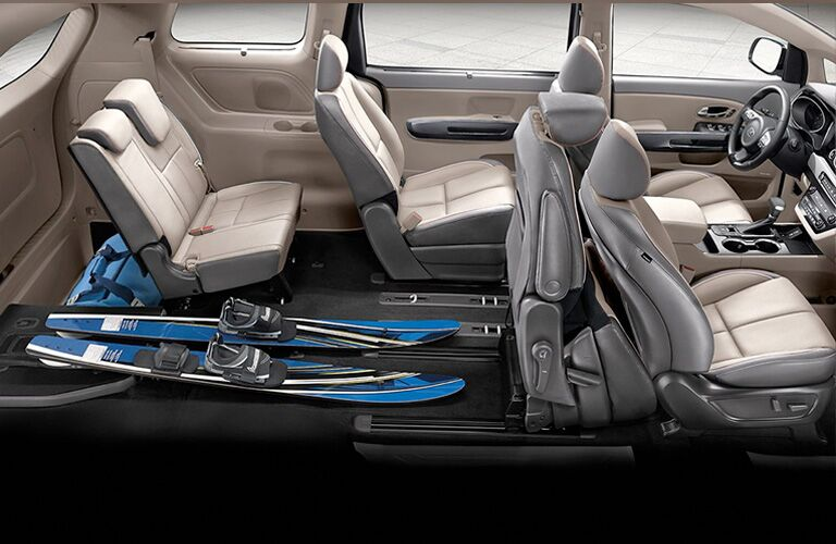 2020 Kia Sedona interior slide and stow seats with skiis on floor