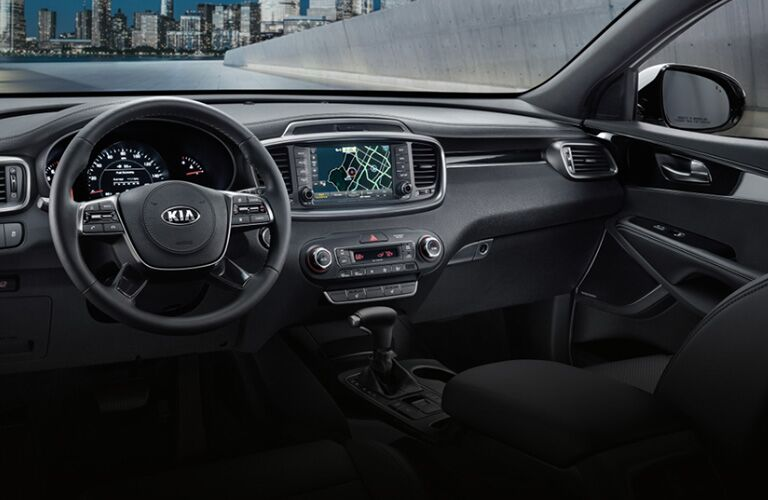 The steering wheel and center console inside a 2020 Kia Sorento.