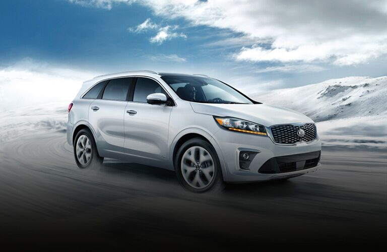 The front and side view of a white 2020 Kia Sorento.