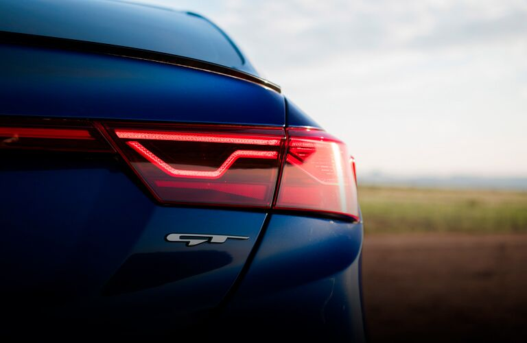 The rear side of a blue 2021 Kia Forte GT-Line model.