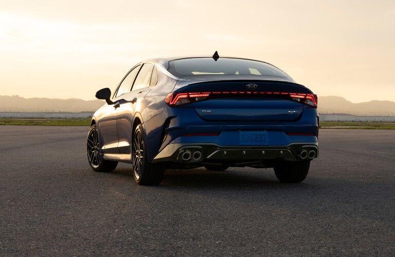 A rear image of a blue 2021 Kia K5.