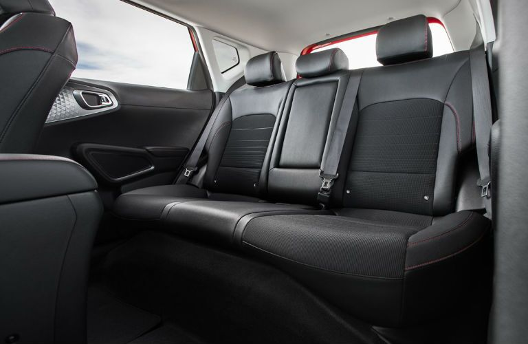 The rear interior seating inside a 2021 Kia Soul.