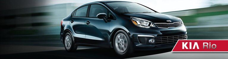 dark colored kia rio driving