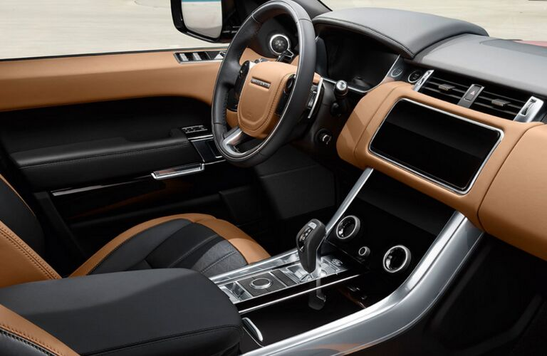 2018 Land Rover Range Rover Sport interior shot of trimming, steering wheel, transmission, and dashboard
