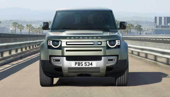 Land Rover Defender driving through city