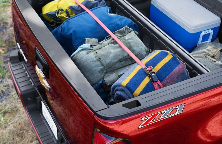 2019 Chevrolet Colorado box filled with camping gear and cooler
