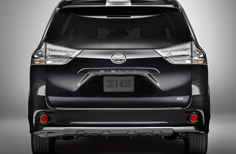 Rear view of 2018 Toyota Sienna parked on gray background