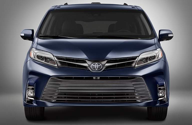 New 2018 Toyota Sienna grille and headlights on gray background