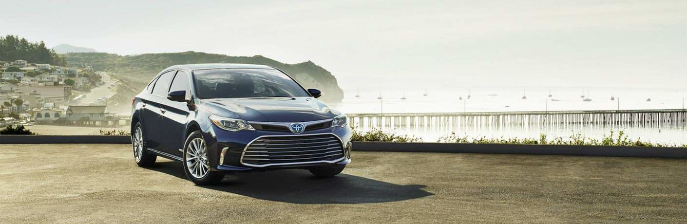 2018 Toyota Avalon Hybrid parked in front of ocean