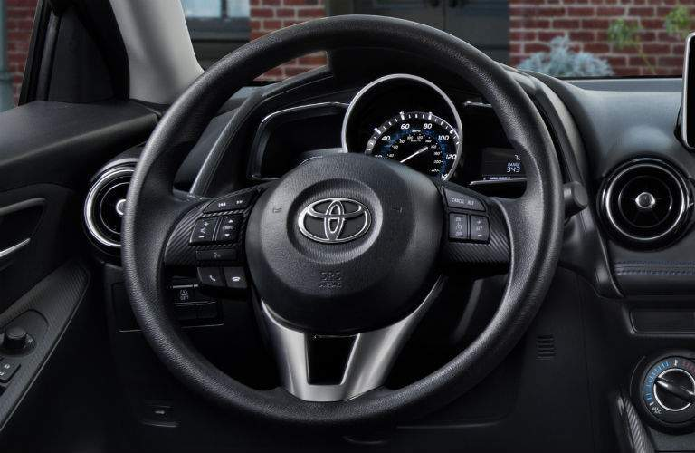 Steering wheel of 2018 Toyota Yaris iA with gauge cluster visible