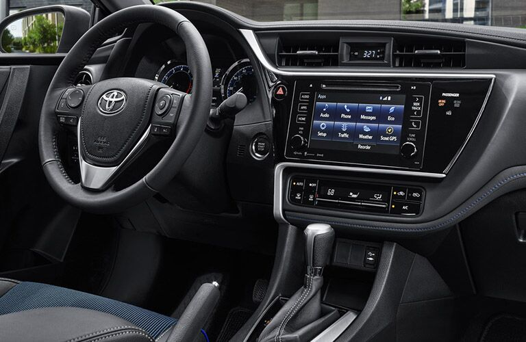 Interior view of 2019 Toyota Corolla closeup of steering wheel and infotainment touchscreen