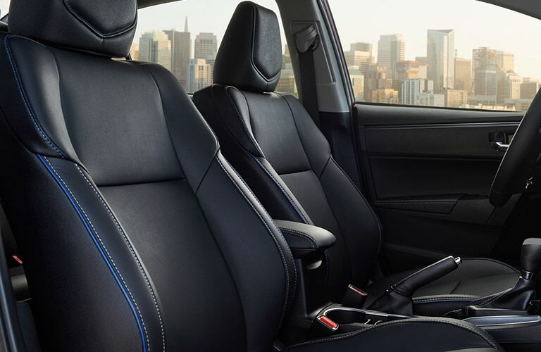 Interior view of a 2019 Toyota Corolla showing black seating with blue trim