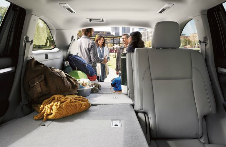 People Having a Conversation Behind the Cargo Area of a 2019 Toyota Highlander